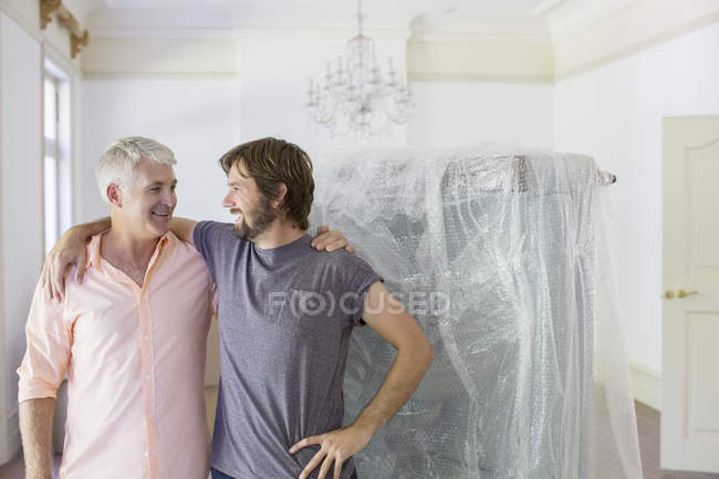 Father and son hugging in living space — Stock Photo