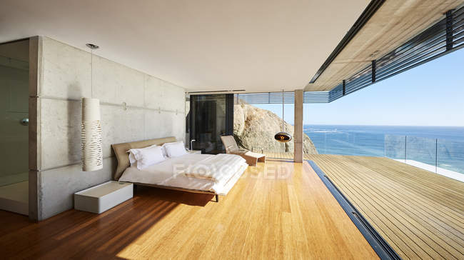 Terrace at luxury modern house against sea — Stock Photo