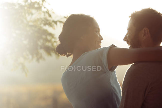 Couple hugging outdoors during daytime — Stock Photo