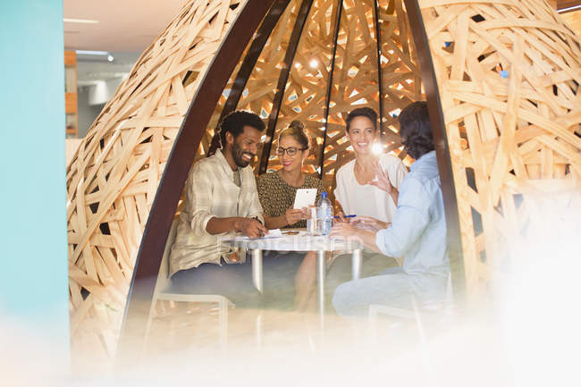 Creative business people meeting in creative workspace teepee — Stock Photo