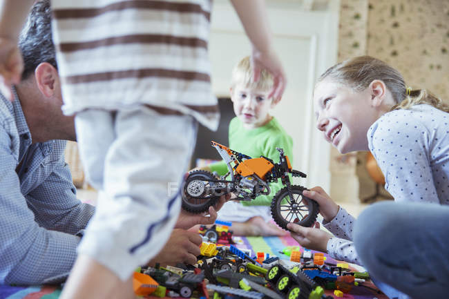 Father and children playing together — Stock Photo