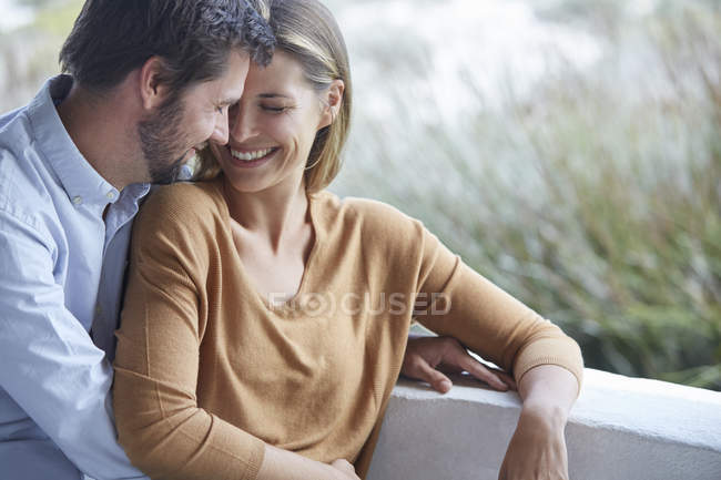 Happy affectionate couple on patio, blurred — Stock Photo