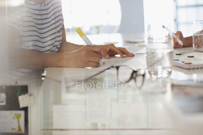 Creative businesswoman brainstorming, writing — Stock Photo