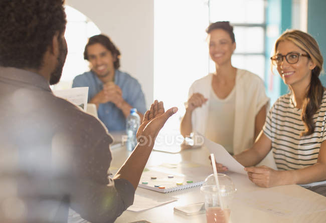Smiling creative business people brainstorming in conference room meeting — Stock Photo