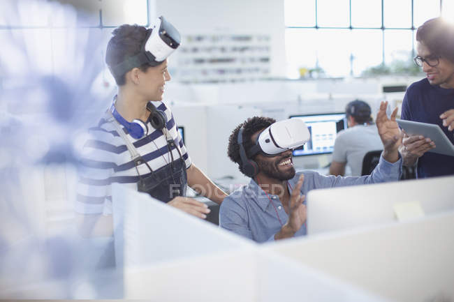 Computer programmers testing virtual reality simulators in office — Stock Photo