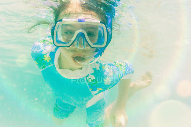 Portrait girl snorkeling underwater — Stock Photo