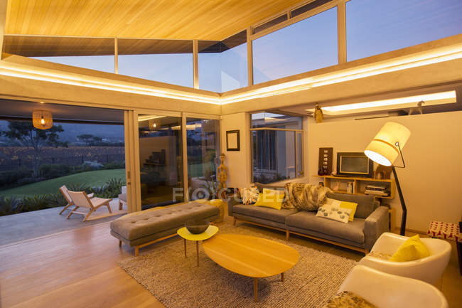 Illuminated modern living room — Stock Photo