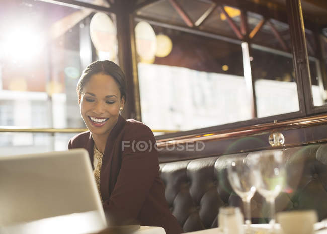Young black businesswoman working in restaurant — Stock Photo