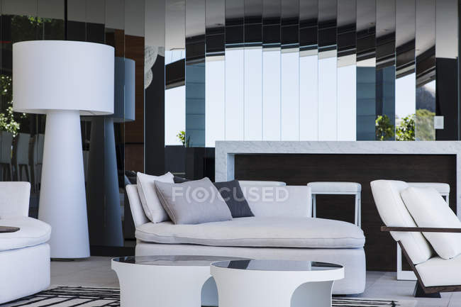 Sofa and mirrors in modern living room — Stock Photo