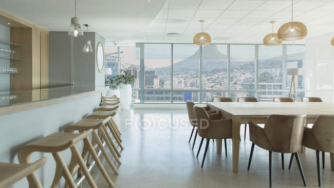 Barstools along counter in urban, modern conference room cafeteria — Stock Photo