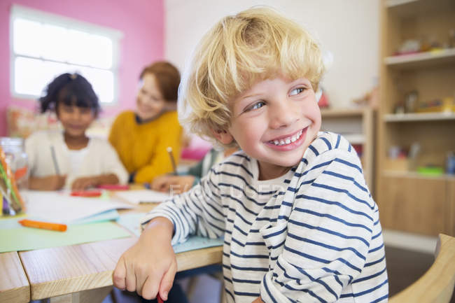 Student smiling in classroom indoors — Stock Photo