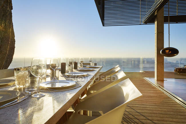 Terrace with table and chairs at luxury modern house — Stock Photo