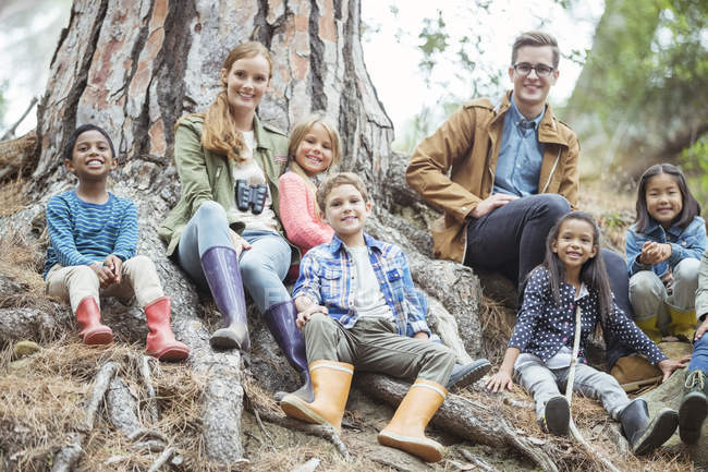 Students and teachers smiling in forest — Stock Photo