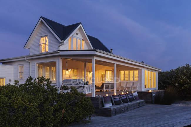 Illuminated white home showcase exterior at night — Stock Photo