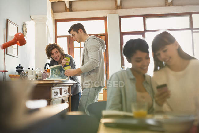 Young friend roommates hanging out in apartment — Stock Photo