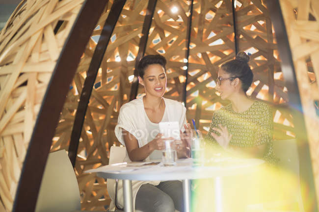 Creative businesswomen meeting, using digital tablet in creative workspace — Stock Photo
