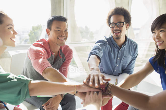 Creative business people connecting hands in huddle — Stock Photo