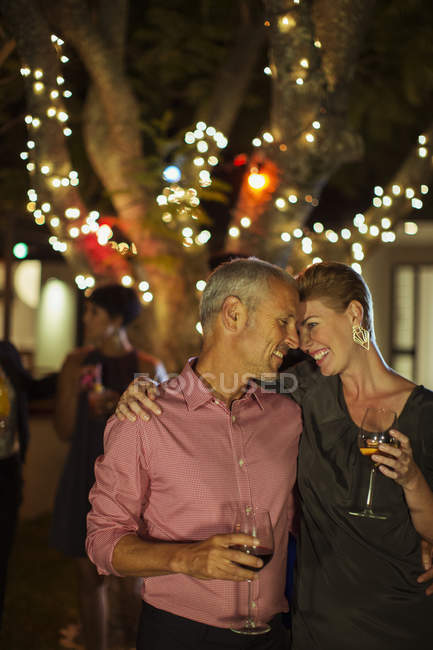 Couple hugging at night party — Stock Photo
