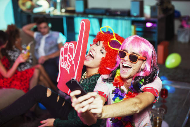 Couple posing in costumes at party — Stock Photo