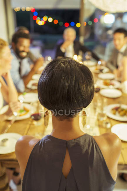 Woman sitting at dinner party — Stock Photo