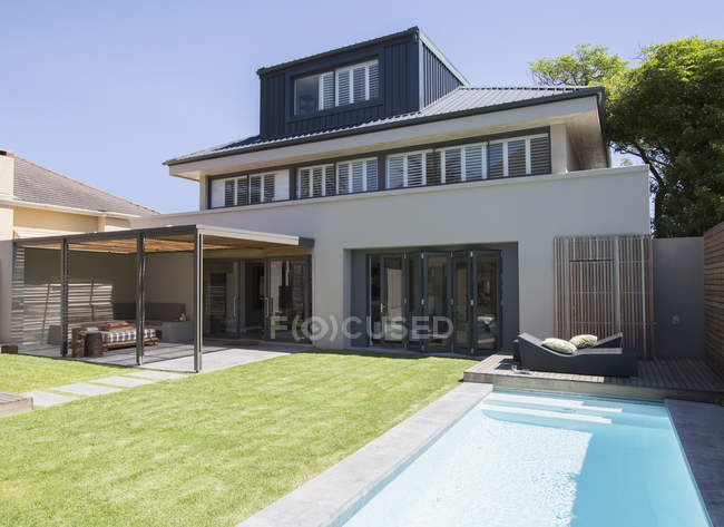 Modern house and lap pool outdoors — Stock Photo