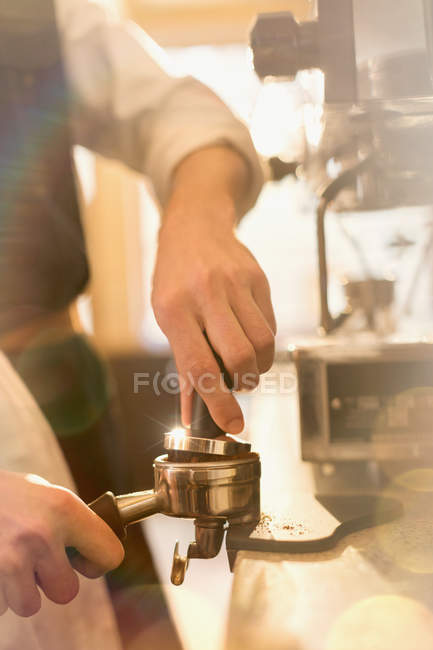 Cropped image of  barista pressing espresso, using espresso machine — Stock Photo