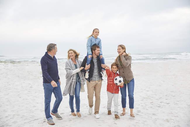 Multi-generation family walking on winter beach — Stock Photo