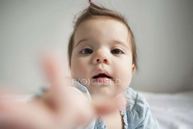 Baby girl reaching out — Stock Photo