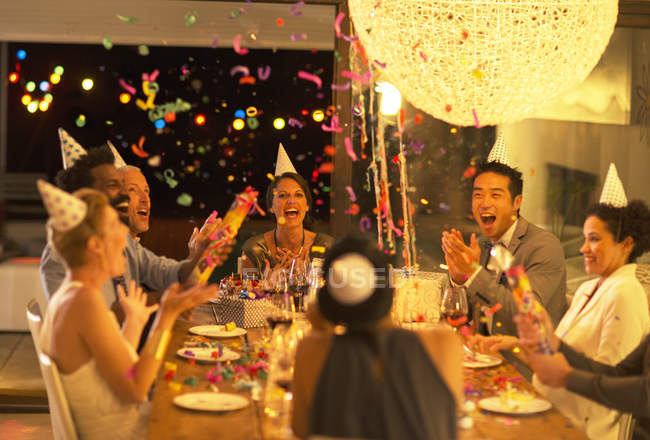 Friends throwing confetti at birthday party — Stock Photo