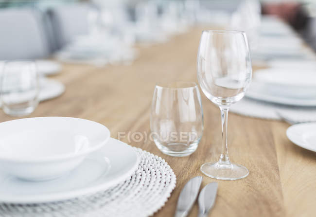 Still life simple placesetting on wood dining table — Stock Photo