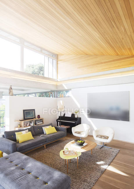 Slanted wood ceiling over living room — Stock Photo