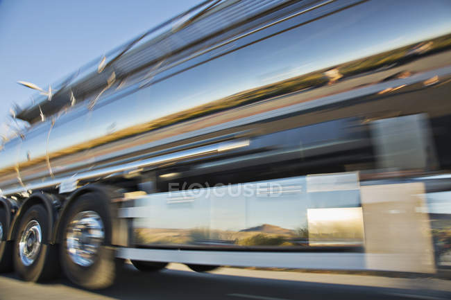 Blurred view of stainless steel milk tanker on the move — Stock Photo