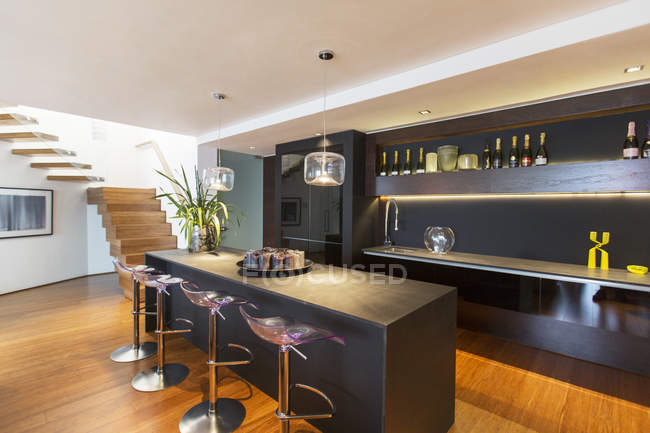 Bar stools and countertop in modern lounge — Stock Photo