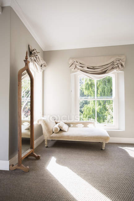 Chaise in sunny luxury bedroom — Stock Photo