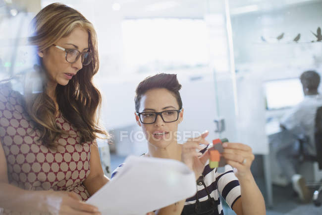 Innovate female entrepreneurs discussing prototype — Stock Photo
