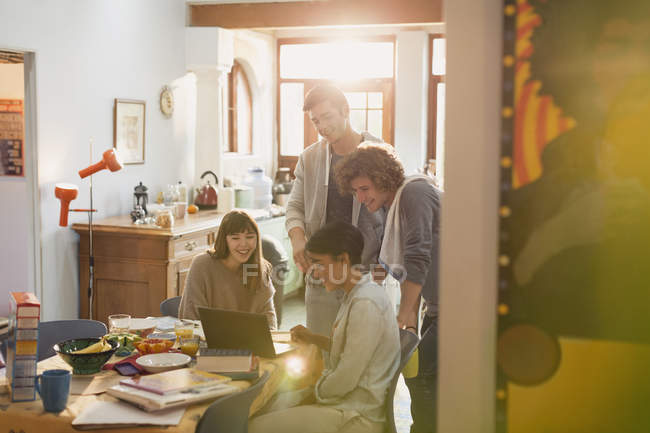 Young friends college students studying at laptop at table — Stock Photo