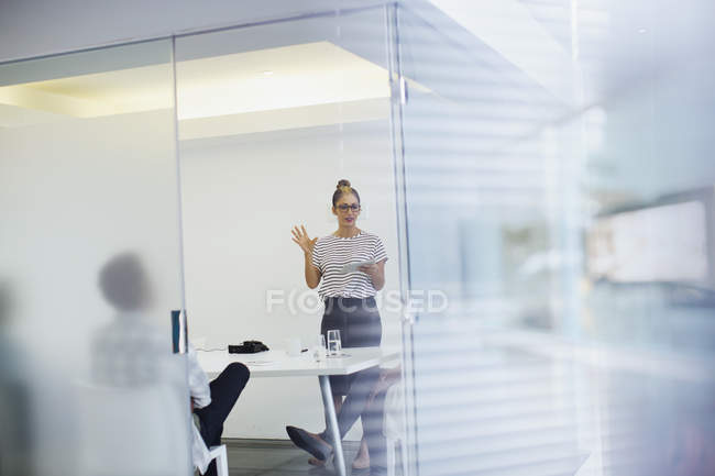 Businesswoman leading conference room meeting — Stock Photo