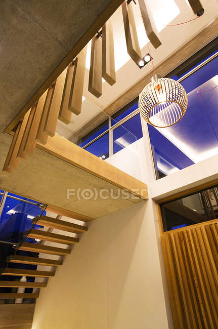 Modern pendant light and stairs in luxury foyer — Stock Photo