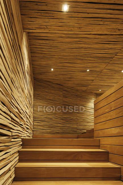 Wooden staircase with illumination indoors — Stock Photo