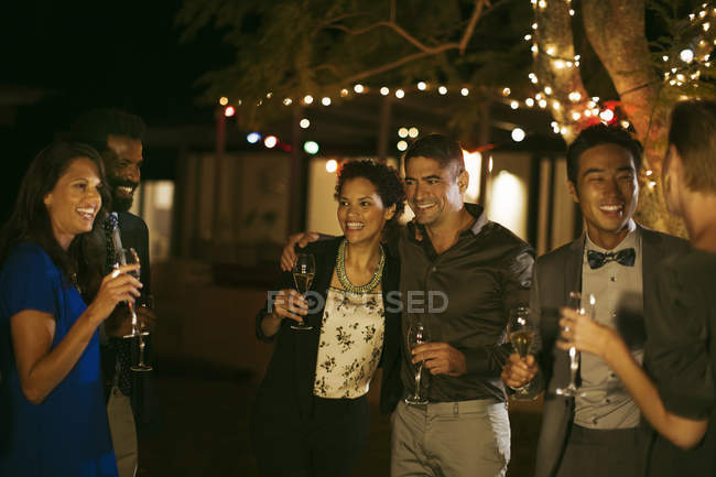 Friends laughing together at party — Stock Photo