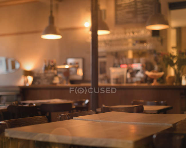 Moody evening time in empty cafe — стоковое фото