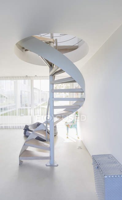 White spiral staircase in modern home showcase interior — Stock Photo