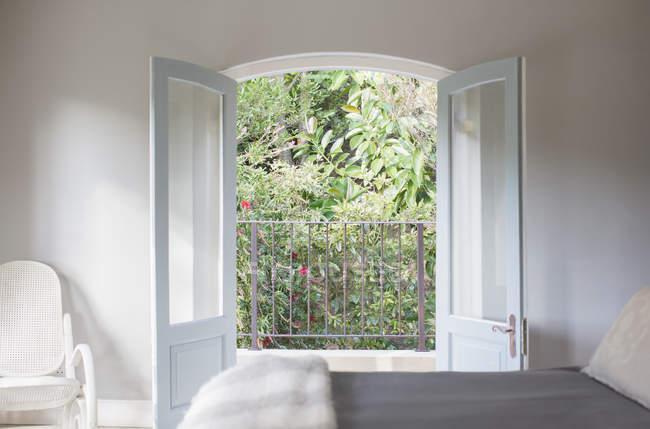 French doors open to balcony in luxury bedroom — Stock Photo