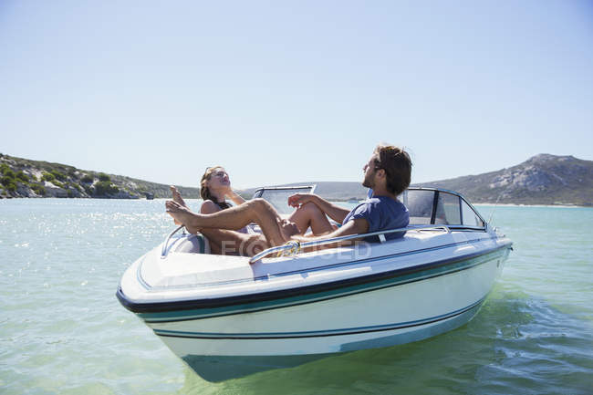 Couple sitting together in boat on water — Stock Photo