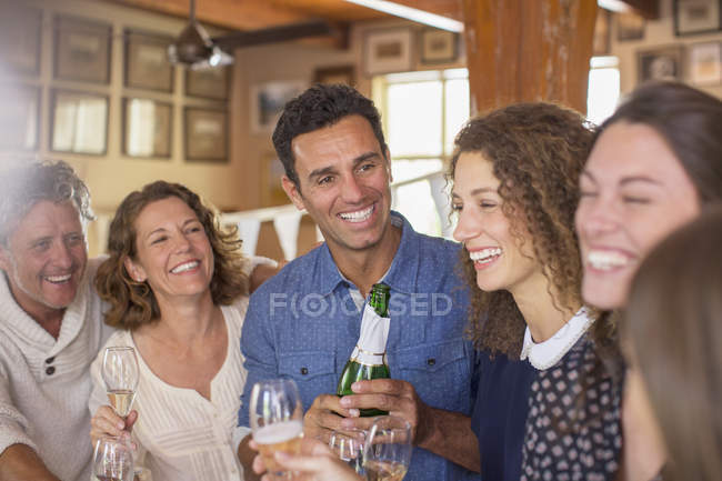 Happy modern family celebrating with drinks — Stock Photo