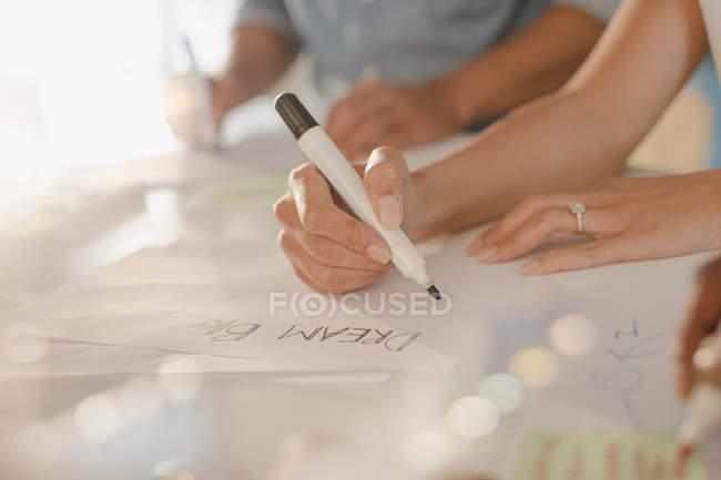 Creative female entrepreneur writing ?Dream Big? on poster — Stock Photo
