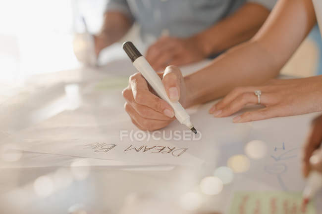 Creative female entrepreneur writing ?Dream Big? on poster — Stock Photo