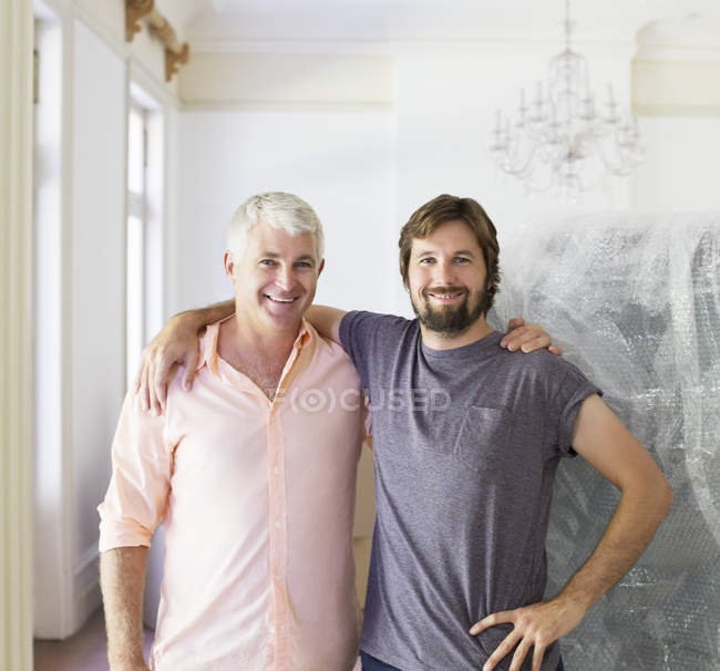 Father and son hugging indoors — Stock Photo