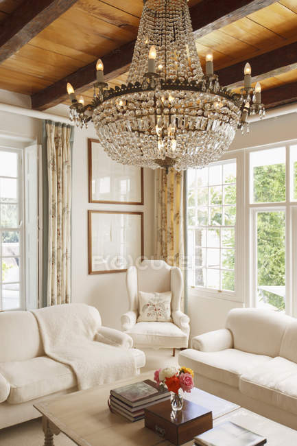 Luxury living room with chandelier — Stock Photo