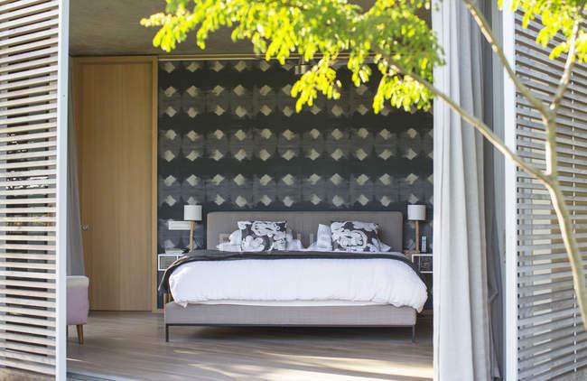 Patio shutters open to luxury bedroom — Stock Photo